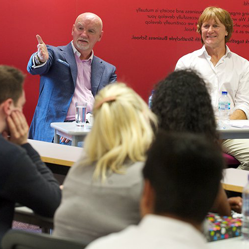 Sir Tom Hunter addressing students