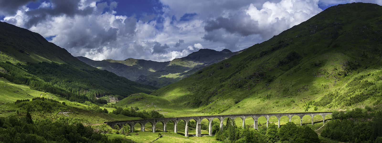 Summer sunlight illuminating the iconic arches of the Gelnfinnan Viaduct
